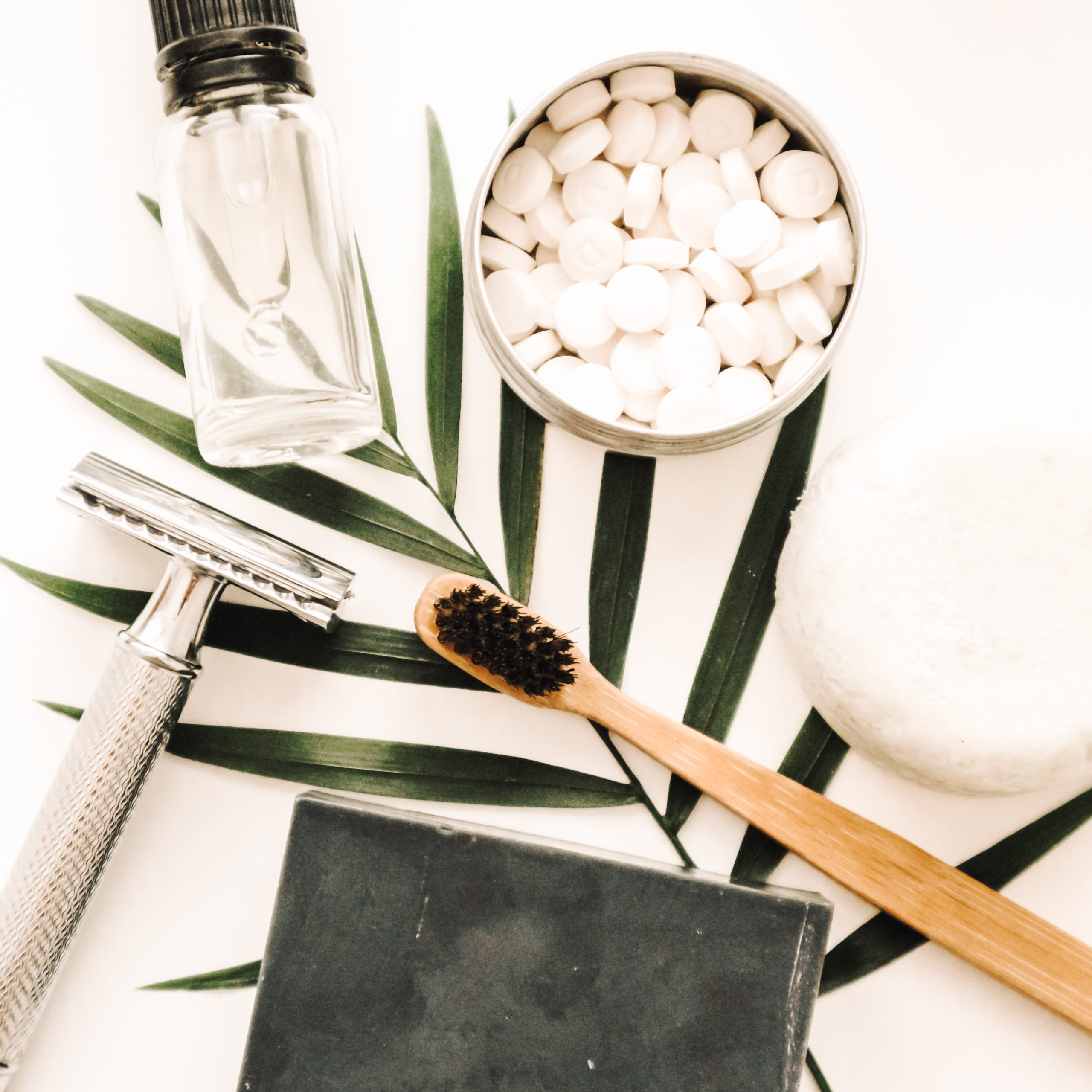 Zero waste and natural beauty products, soap, bamboo toothbrush, razor.