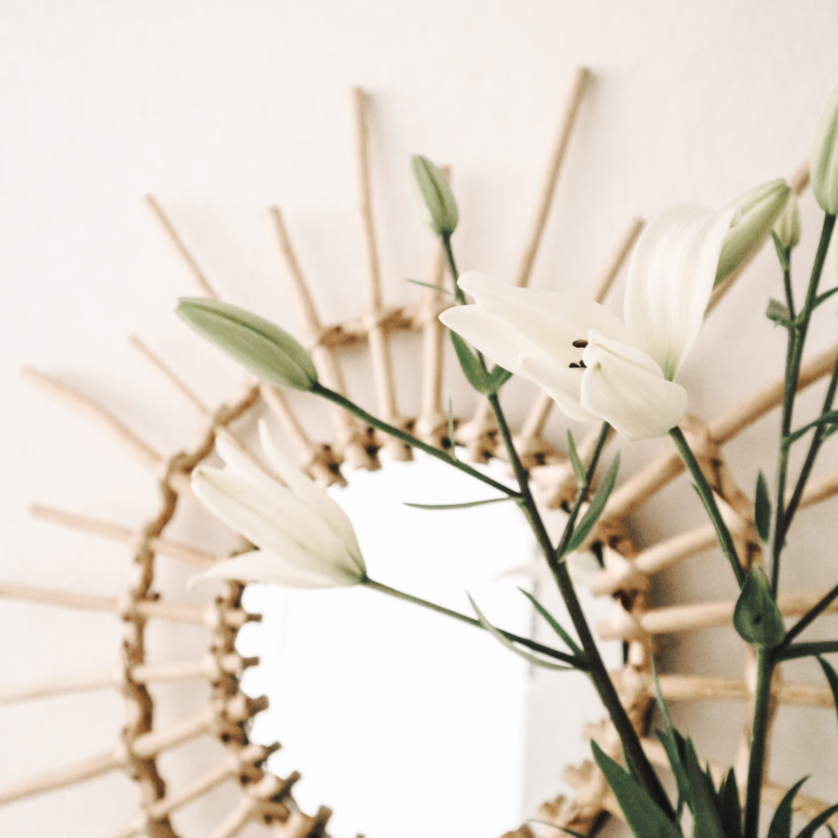 Sun mirror and white lilies.