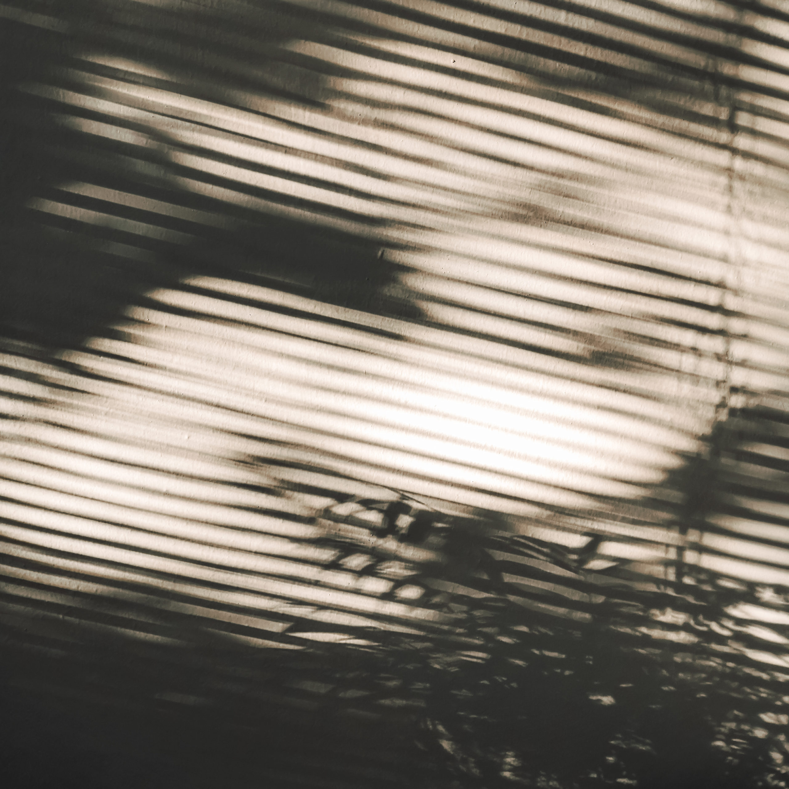 Shadows from the blinds.
