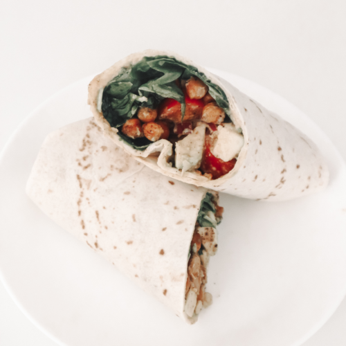 Vegan wrap with spinach, chickpeas and avocado.